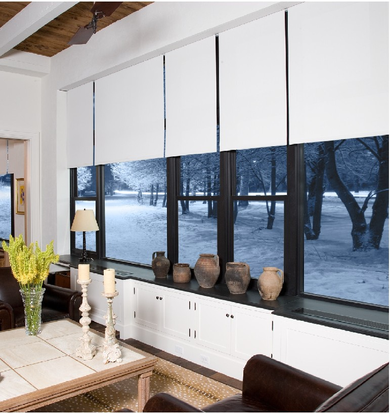Properly installed shades with opaque fabric doubles energy efficiency and reduces heat loss by 50%.